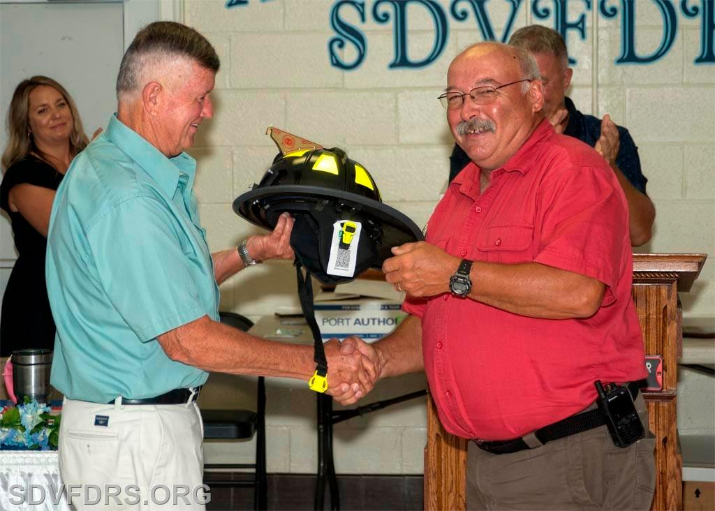 The Firefighter of the Year Award is presented to Francis Bean for the fourth time while a member of the SDVFDRS.