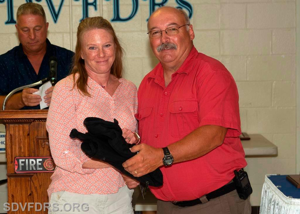 Kim Collins is presented with the EMS Provider of the Year Award by Chief Joy.
