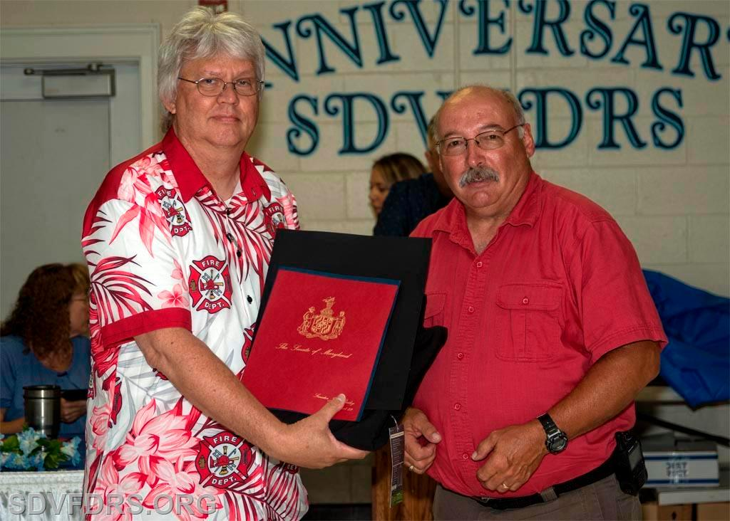 Mike Wilson receives recognition for 25 Years of Service to the SDVFDRS, presented by Chief Gary Joy.