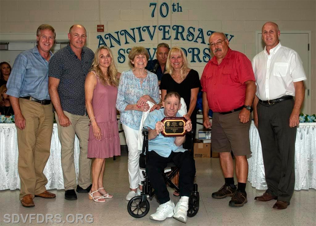 The family of Mike Johnson accepting a posthumous award for his many years of dedicated service to both the SDVFDRS and the Auxiliary.